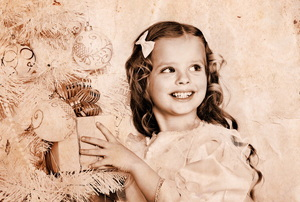 A retro looking photo of a girl next to Christmas tree.