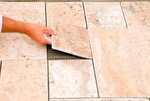 Worker Placing Final Floor Tile