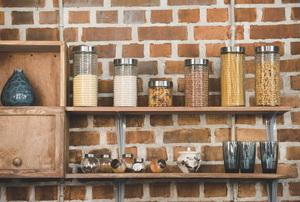 shelves along a kitchen wall