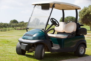 A golf cart sitting on the fairway