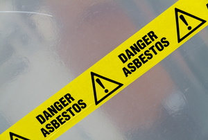 "A sign says ""danger asbestos."""