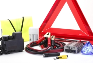 a car care kit with jumper cables and other items