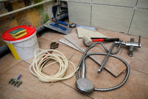 Tools and materials standing by for a bathroom remodel.