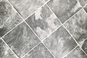Grey marbled vinyl tiles.