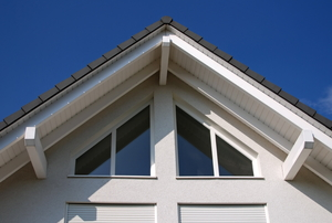 A roof gable with fascia boards facing outward.