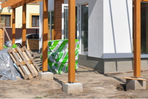 wood frame posts mounted to concrete blocks outside a building