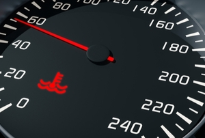 car dashboard display with engine coolant light on