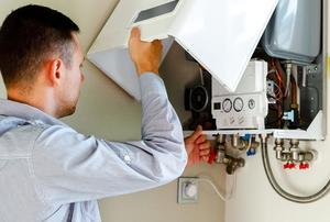 person repairing boiler device