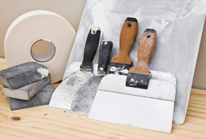 A trowel and other equipment.