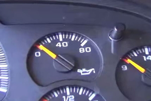 An oil pressure gauge with the needle sitting at zero.