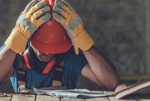 disappointed construction worker made a mistake looking at plans