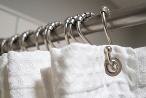 shower curtain rod with white curtain