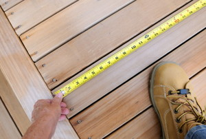 taking a measurement on a deck