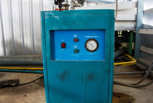 Teal-colored swamp cooler in a shop