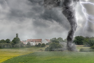 tornado whirling through green field