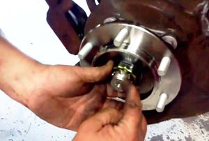 man working on a wheel bearing