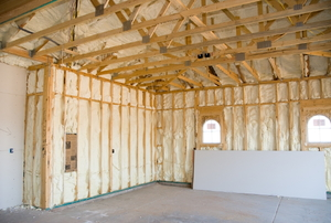 Spray foam insulation in the walls of an unfinished room.