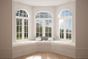 Three large windows with bench seating