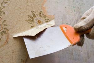 Peeling wallpaper off a wall