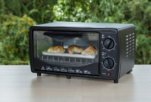 black toaster oven with crossiants inside