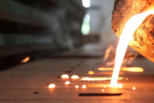 molten metal pouring into molds