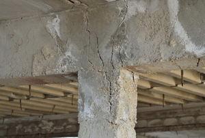 A cracked cement column.