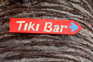 Tiki bar sign on  tree