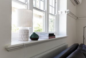 A white living room with sash windows.