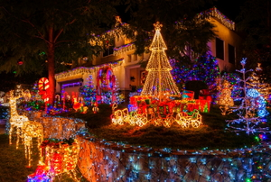 An elaborate display of Christmas lights outside a home.