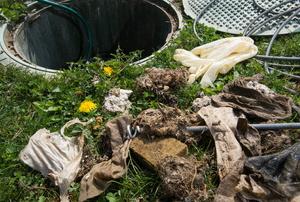 Lid and debris near septic tank