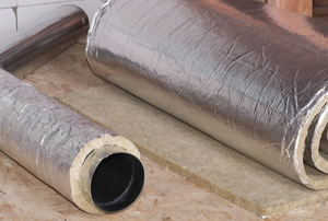 air duct on floor wrapped in metalic coated insulation