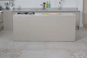 kitchen with white cabinets and laminate tile flooring