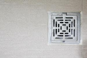 A drain in a floor.