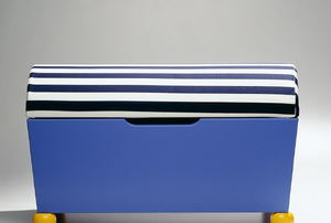 A blue wood ottoman with a striped lid.