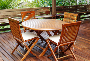 Teak dining set on a deck