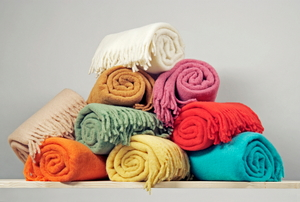 A stack of brightly colored blankets.