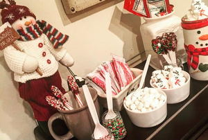 A hot chocolate bar decorated with snowmen.