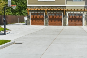 a concrete driveway in front of a house