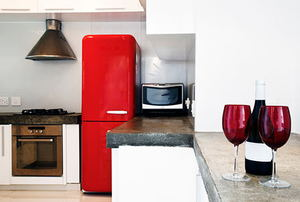 Red fridge and wine glasses in domestic kitchen