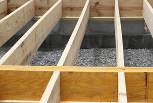 A frame constructed with floor joists for a home.