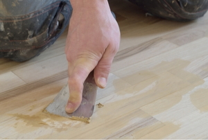A man using wood putty.