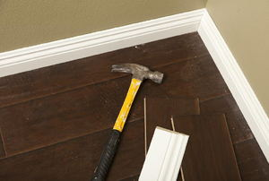 Baseboards with a hammer on it