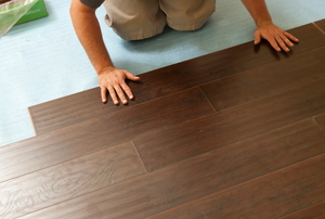 Person installing laminate flooring