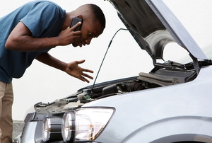 a person looking into the hood of a car