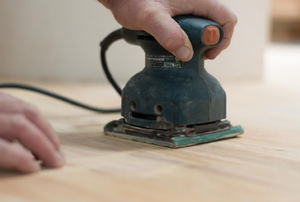 A sander on a wood floor.