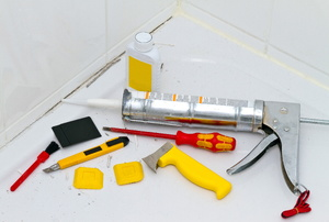 Assorted tools for tile grout removal.
