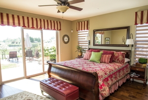 a bedroom with window valances