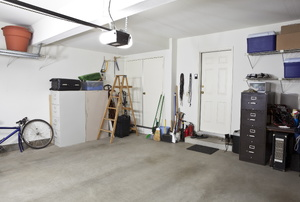 A garage with concrete floors.