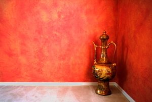 Large middle eastern decorative pot and faux finish walls.