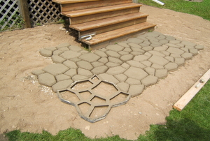 A decorative geometric pattern in a concrete pathway.